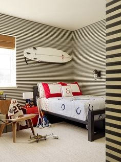 It All Hinges On...love the surf board over the bed