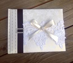 A personal favorite from my Etsy shop https://www.etsy.com/listing/295145893/beautiful-handmade-wedding-guest-book
