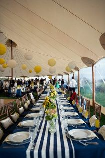 White table cloth, blue and white table runner, yellow centerpieces