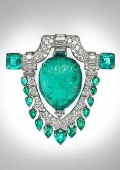 Wow...carved 60 ct. Mughal emerald and diamond brooch!