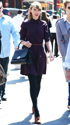 APRIL 3, 2014 Swift styled her checkered shirtdress for cooler weather with knitted tights and Oxford heels.