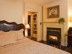 A King size bed, gas fireplace, HDTV and two comfortable club chairs.