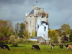 Joe Caslin's mural on the side of a 15th century tower house castle in Galway.