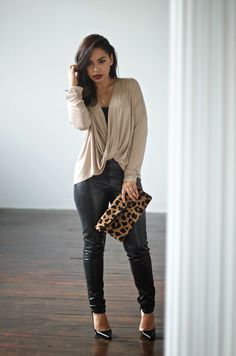 The Love,Cortnie 'Ashleigh' clutch paired with a neutral and faux leather pants.  (via Alana Marie Style: Draped Surplice Top)