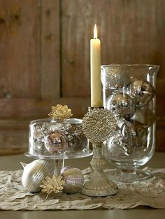 Silver and Gold = Christmas table groupingI love this silver holiday decor.I'm gonna get me some old silver ornaments this season.silver holiday decor & an idea to decorate candle sticks with a broach!Merry and Bright: Christmas Wedding Centerpieces Christmas Wedding Centerpieces, Silver Christmas Decorations, Christmas Themes, Silver Ornaments, Table Centerpieces, Christmas Candles, Christmas Vignette, Silver Baubles, White Centerpiece