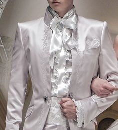White satin Beethoven ruffled shirt and nacre floral embroidered matching with cummerbund.