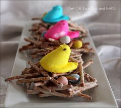Peeps in a nest - chocolate covered pretzels make the bird nests and you can use mini eggs inside and place the marshmallow Peeps on top! So cute for Easter!
