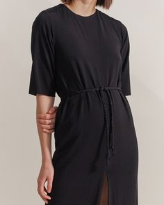 The Moonwalker Dress is a loose-fitting, fully lined dress in a fine viscose blend jersey. Features front and back slits. It comes with a hand braided sash of the same material using leftover material after the dress is cut to reduce waste. By Ade Velkon womens brand #fashiondiscovery #AdeVelkon #Dress #fashion #style #designers_dresses #dress_style #casual_dresses #womens_dresses #fashion_dresses #dresses_outfit #flowy_dresses #black_dress Flowy Dresses, Casual Dresses, Reduce Waste, Women Brands, Sash, Dress Fashion, Designers, Things To Come, Product Description