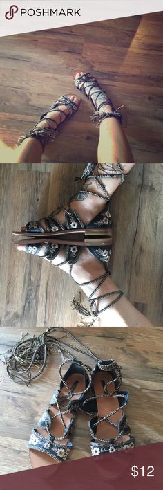Lace up gladiator sandals Super cute flower sandals with ties. Size 7 brand forever 21. Worn a couple times Forever 21 Shoes Sandals