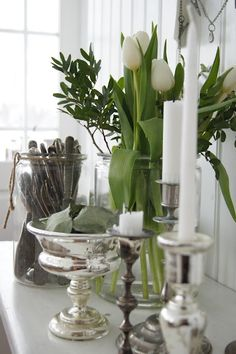 Silver & white tulips...perfect table setting for Spring. You can get Silver vases (not real) at Michael's, Hobby Lobby, etc.