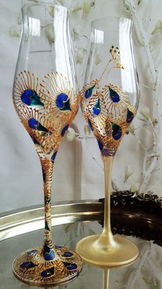 Set of 2 hand painted wedding champagne flutes Peacock theme wedding glasses in gold, blue and turquoise color Cake serving set Wedding Wine Glasses, Diy Wine Glasses, Wedding Champagne Flutes, Hand Painted Wine Glasses, Champagne Glasses, Wine Bottle Crafts, Bottle Art, Peacock Ornaments, Ring Pillow Wedding