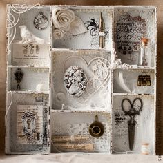 Cardboard shadowbox with interesting things and backgrounds in each cubby.