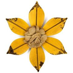 """Tip toe through the tulips. Create a wonderful wonderland of floral proportions with Yellow Metal Flower with Burlap Center. This lovely flower features 6 petals with a slight distressed appearance at the tip and a layered burlap flower in the center. Turn your home or office into a garden of delight.        Dimensions:      Width: 10""""          Hanging Hardware: 1 Keyhole Hanger"""