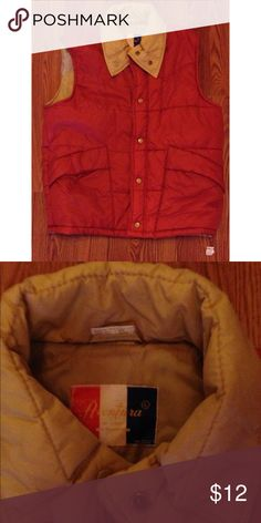Men's Vintage Aventura Puffer Vest This is a vintage men's Aventura puffer vest. It is Burnt Orange, with the inside Tan. The shell and lining are 100% Nylon. The padding is 100% polyester. It has two front-closure pockets. It is a button down and is a Large. Jackets & Coats Vests