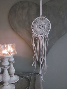 A vintage lace doily dream catcher adorned with some by SierGoed, €29.95
