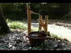 """I want a Shishi-odoshi : """"Deer Chaser:"""" water-filled bamboo tube which clacks against a stone when emptied; device for scaring deer off from gardens."""