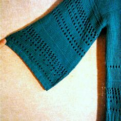 Fever - teal color sweater Pretty coo! Crochet knit, teal colored scoop neck top. Look at the flared sleeves!! Fever Sweaters