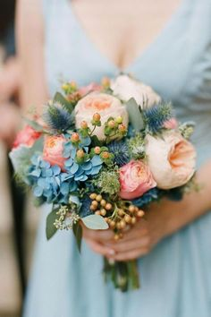 Wedding Flowers Globe thistle and hydrangeas are stunning blue accents to the peach flowers in this wedding bouquet.Globe thistle and hydrangeas are stunning blue accents to the peach flowers in this wedding bouquet. Small Wedding Bouquets, Hydrangea Bouquet Wedding, Spring Wedding Flowers, Bride Bouquets, Bridal Flowers, Floral Wedding, Bouquet Flowers, Wedding Blue, Trendy Wedding