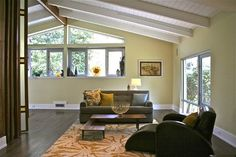 mid century modern ranch - notice the bi-folding stainglass-like panels that can be pulled across the room. Very, very nice.