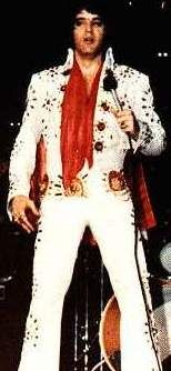 """On stage in Detroit april 6 1972. Ending the show.Today """"the White pinwheel suit"""" is at Graceland but the belt was sold at the Hard rock cafe concession. in the 90'"""