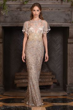 """Claire Pettibone """"Zodiac"""" Dress: Taupe wedding gown with metallic beading and sheer emobroidered short sleeve overlay. 