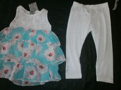 http://www.ebay.fr/itm/Vetement-fille-Neuf-Ensemble-tunique-robe-blanche-fleur-leggings-Turq-6-ans/251945183064?_trksid=p2047675.c100010.m2109
