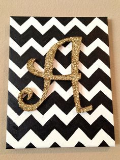 chevron background with a wooden glitter letter on top.