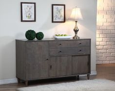 Add a stylish touch to your dining room with the Vilas light charcoal grey buffet. Constructed of durable wood,this piece features matte black pulls and two