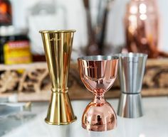 This set of double cocktail jiggers includes three beautiful jiggers made from stainless steel. Each jigger is fashioned into a different design with a unique finish. Copper, Brass, Bar Tools, Coffee Maker, Candle Holders, Cocktails, Stainless Steel, Canning, Elegant