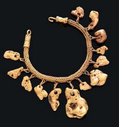 Exceptional bracelet made of a braided chain to which hang twelve small nuggets of pure gold with a filigree clasp, Gold, Thrace, 500 - 400 BC. Comparative Literature: Özgen I. & J. Öztürk, Heritage: recovered. The Lydian Treasure catalog Exhibition, Istanbul, 1996, p. 137, No. 92. | J. Ogden, Jewellery of the Ancient World, 1982, p. 18, Fig. 2