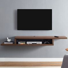 """The modern flair and the appearance of a floating shelf. makes the Ascend 72"""" Asymmetrical Wall Mounted TV Component Shelf the perfect addition to any living room. This bold design is functional and visually striking. The wall console accepts 2 audio/video components side by side and a sound bar on the top shelf. It holds up to 70 Lbs. and comes with screws for standard wood stud wall installation. The wall mounted console boasts concealed wire management."""