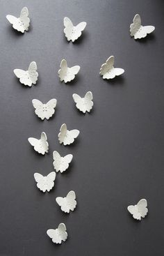 White porcelain wall art sculpture Flutter    these are lovely.  Set of six lace wing butterflies with antique embroidery details and sterling silver wire. $129.00, via Etsy.