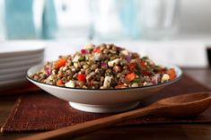 Cooked lentils are tossed with peppers, onions, mint, Italian dressing, garlic and feta cheese for a unique salad.  For added flair, serve in red pepper halves, if desired.