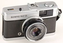 The Trip 35 is a 35mm compact camera, manufactured by Olympus. It was introduced in 1967 and discontinued, after a lengthy production run, in 1984. The Trip name was a reference to its intended market – people who wanted a compact, functional camera for holidays. During the 1970s it was the subject of an advertising campaign that featured popular British photographer David Bailey. Over ten million units were sold