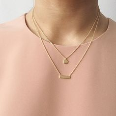Lovely delicate gold necklace that are perfect for layering. Those simple yet cute necklaces are made out of sterling silver and are available in silver and gold. A small circle disc necklace paired with a small bar necklace are perfect for everyday wear.