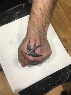 Swallow hand tattoo by @scentless.apprentice