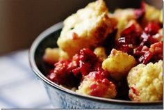 Curried Cauliflower & Cranberries    4 cups cauliflower, cut into florets   3/4 cup fresh cranberries   1 clove garlic, minced   2 tbsp coconut oil (you can reduce to 1 if you wish)   1 tbsp curry powder   1 tbsp agave or maple syrup   Kosher salt   Black pepper    1) Set oven to 375 degrees. Line a large baking sheet with tinfoil.    2) On top of the foil, mix the cauliflower, cranberries, garlic, oil, curry, agave, and salt and pepper to taste.    3) Bake for 35-40 minutes, or until cauliflower is golden and cranberries are popping and turning dark.