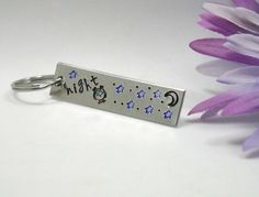 Use coupon code 10FOR20 for 10% off your order of $20.00 or more!    Night (Owl with stars and a moon stamp) Night Owl Keychain    Personalized