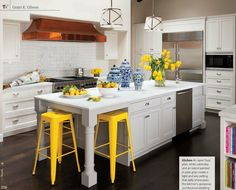 This stunning kitchen by San Francisco-based designer, Grant K. Gibson features cheerful yellow accents, classic tile, hardware, and cabinetry selections, along with a pair of Visual Comfort's Grosvenor Pendants.