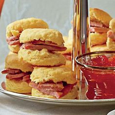 Sweet Potato Biscuits | Serve these from-scratch biscuits warm with butter, honey, and jam, along with two platters—one with seared slices of country ham and pepper jelly and another with deli ham and pimiento cheese. | SouthernLiving.com