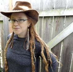 Extra long leather tassel earrings with 9mm bullet shells and antique brass chain. Available now in my shop! wildgingercreations.etsy.com