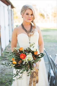Funky bridal looks with fall inspired bouquet. #weddingchicks Captured By: Lightbox Photography http://www.weddingchicks.com/2014/06/20/funky-braided-wedding/