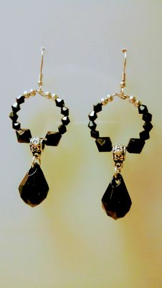 Hoop earrings with black Bicknell beads and briolettes. #beadedearring
