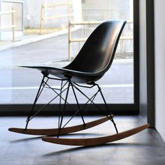 Eames rocker. Ours is so cool. It is vintage brown naugahyde with black edging on walnut rockers.