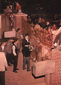 Elvis loved to walk out to the gates at Graceland and talk with the fans.  March 12, 1960