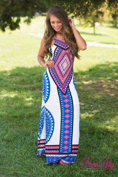 This brilliantly decorated aztec print dress is perfect for your next date night or summer wedding reception! It features a bold aztec pattern in red, pink, mint, blue, and white on a maxi dress. There's also a halter top with adjustable spaghetti straps, and slits on each side up to mid-thigh.