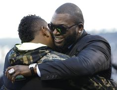 Giants third baseman Pablo Sandoval (left) hugs David Ortiz, who is part of the Fox broadcast team covering the World Series, before Game 1 on Tuesday. (Matt Slocum/Associated Press)