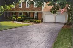 Concrete driveway cost depends on many different things. I'll answer the question what is the cost of a concrete driveway and explain why a cement driveway cost more than an asphalt driveway. Cost Of Concrete Driveway, Concrete Driveway Resurfacing, Stone Driveway, Driveway Design, Driveway Landscaping, Outdoor Landscaping, Driveway Ideas, Patio Ideas, Yard Ideas