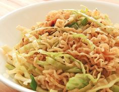 Ingredients      1/2 large head cabbage, coarsely chopped  1 (3 ounce) package ramen noodles, crushed  1/2 cup sunflower seeds    1/2 cup vegetable oil  3 tablespoons white sugar  3 tablespoons distilled white vinegar      Directions    Toss together the cabbage, noodles and sunflower seeds or almonds.  Whisk together