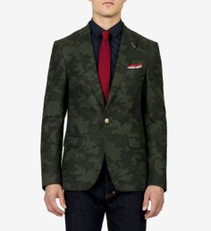 SALE | Van Gils Camo Blazer by GOTSTYLE Online $297.50 | Camouflage is given grown-up polish with this blazer- courtesy of the much admired, Dutch design house, Van Gils. The structured piece is ultra masculine, uniquely detailed with a bronze lapel pin and lends serious military might to off-duty basics. Combats lacklustre fall style when paired with dark denim, chinos and tees. | GOTSTYLE.ca